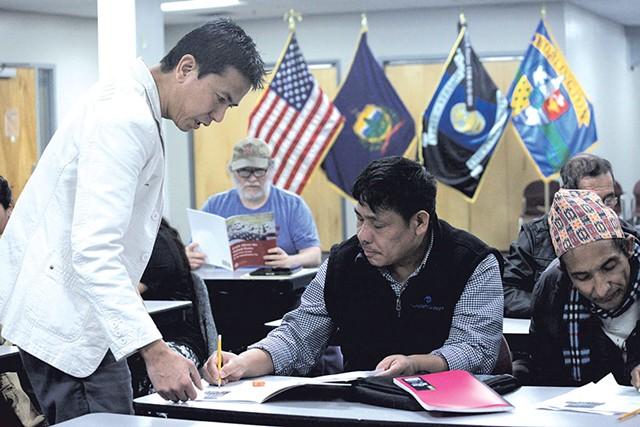 Hemant Tamang-Ghising teaching a citizenship class - MATTHEW THORSEN