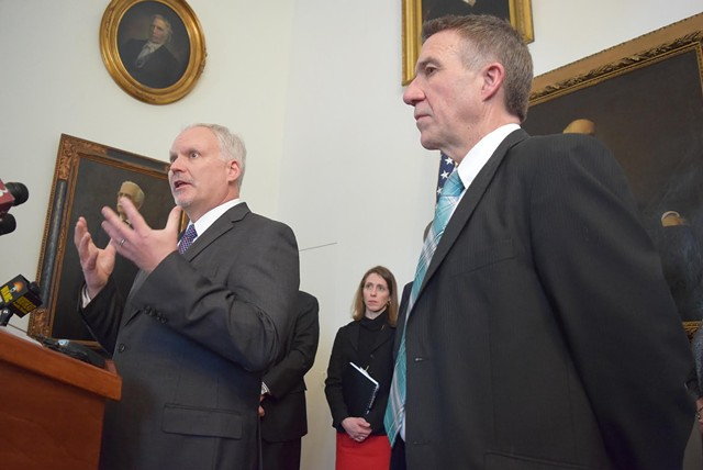 OneCare CEO Todd Moore addresses reporters with Gov. Phil Scott to his right. - FILE: TERRI HALLENBECK
