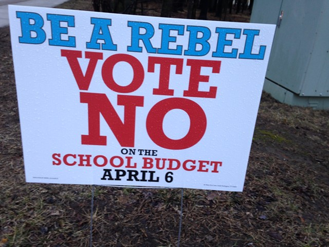 Sign encouraging voters to defeat budget - MOLLY WALSH