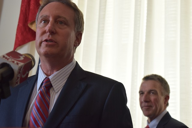 Court-appointed receiver Michael Goldberg discusses the settlement as Gov.  Phil Scott looks on. - TERRI HALLENBECK