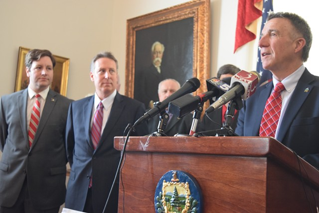 Gov. Phil Scott (right) talks Thursday as court-appointed receiver Michael Goldberg (middle) and Department of Financial Regulation Commissioner Mike Pieciak listen. - TERRI HALLENBECK