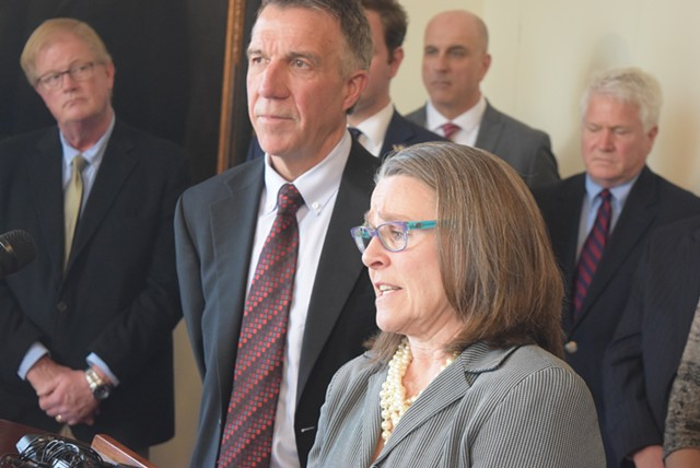 Gov. Phil Scott and his legal counsel, Jaye Pershing Johnson, at a press conference Tuesday - TERRI HALLENBECK