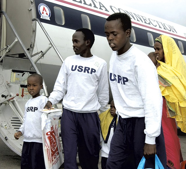 Haji, left, arriving in Vermont in 2003 - COURTESY OF THE BURLINGTON FREE PRESS