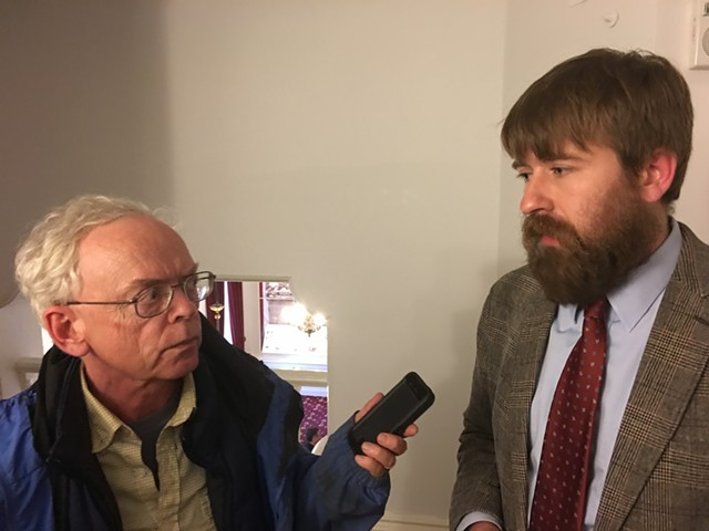 VTDigger's Mark Johnson interviews Paul Heintz of Seven Days and the Vermont Press Association after Wednesday's House vote on S.96. - JOHN WALTERS