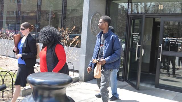 Josiah Leach, center, leaves court with attorney Elizabeth Quinn, left, and his mother, Joy McKenzie - MARK DAVIS
