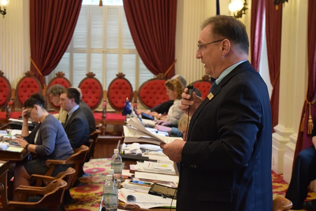 Rep. George Till (D-Jericho) speaks for a paid family leave bill on the House floor Tuesday. - TERRI HALLENBECK