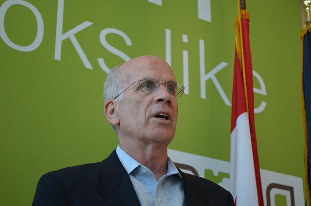 Rep. Peter Welch (D-Vt.) speaks at a press conference at the Burlington International Airport Tuesday. - ALICIA FREESE