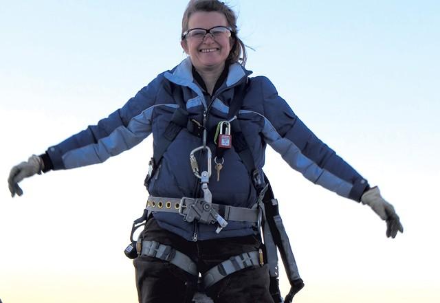 Sally Wright atop a wind turbine - COURTESY OF SALLY WRIGHT