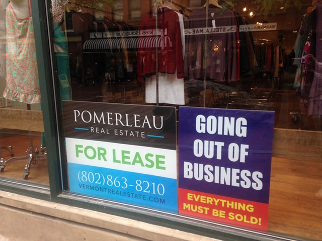 Signs in the 2nd Time Around store windows - MOLLY WALSH