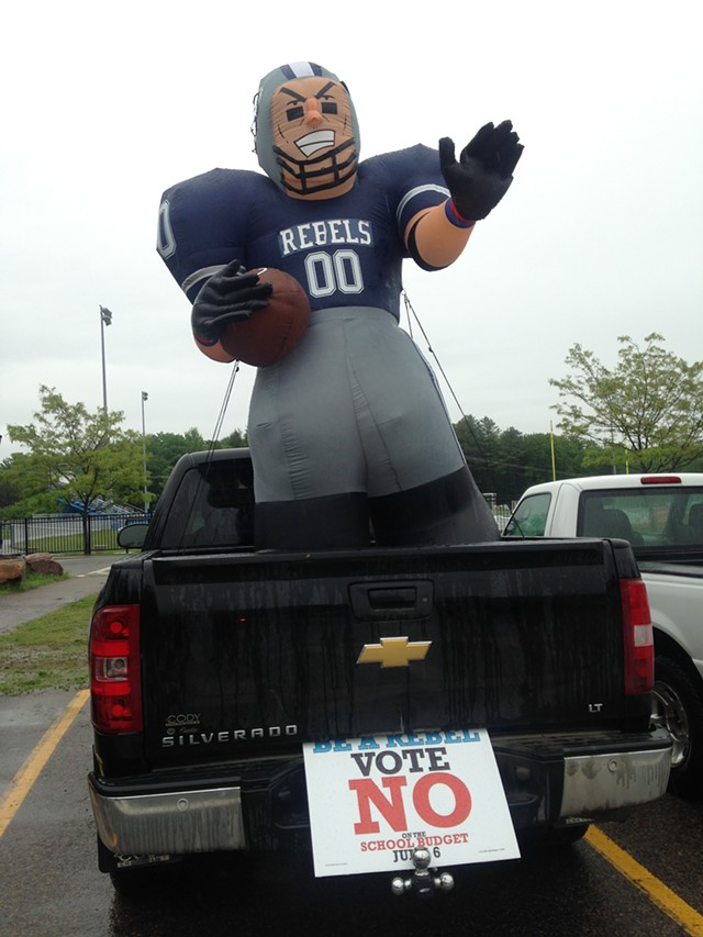 A truck in the parking lot near voting at Tuttle Middle School. - MOLLY WALSH