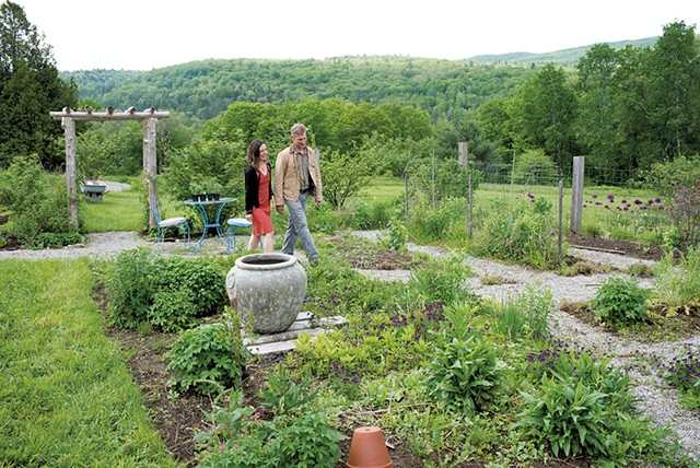 Sam and Kathryn Wyatt in their Lincoln home's front gardens - CALEB KENNA