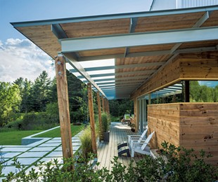 The outside deck showcases the home's floor-to-ceiling windows and doors. - JIMWESTPHALEN