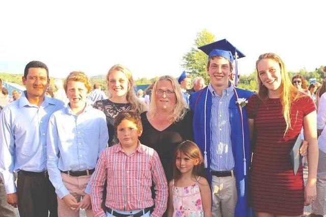 Juan (left) and Kirsten (center) De La Cruz with their children - COURTESY: KIRSTEN DE LA CRUZ