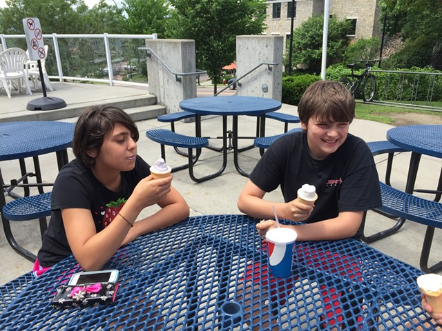 Savannah Werner and James Clancy of South Burlington eat creemees at Burlington Bay on the second day of summer vacation - SALLY POLLAK