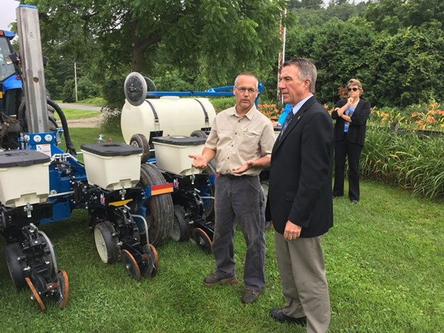 Lorenzo Whitcomb, owner of the North Williston Cattle Co., and Gov. Phil Scott - JOHN WALTERS