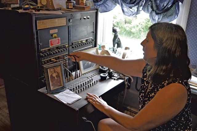 Franklin Telephone manager Kim Gates - showing off the company's antique equipment - TERRI HALLENBECK