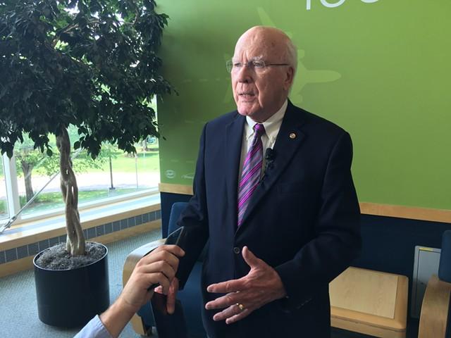 Sen. Patrick Leahy speaks to reporters at Burlington International Airport - JOHN WALTERS