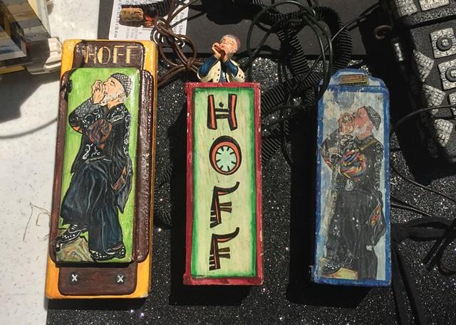Three Hoffman-themed harmonica cases - RACHEL JONES