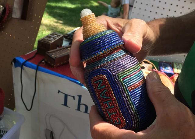 Baby bottle harmonica case to commemorate Hoffman's grandson - RACHEL JONES