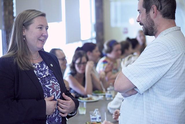Jessie Baker talking to a Winooski resident at the O'Brien Community Center - MATTHEW THORSEN