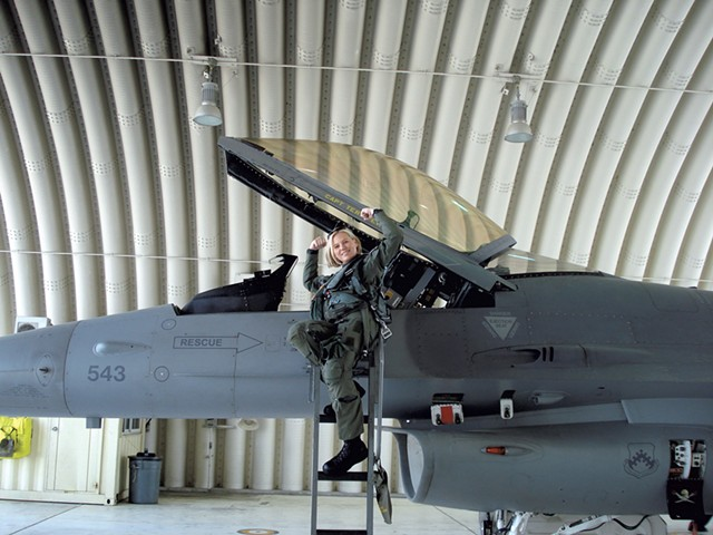Major Sherry with her F-16 in South Korea, demonstrating a common greeting among fighter pilots - COURTESY OF TERRY SHERRY