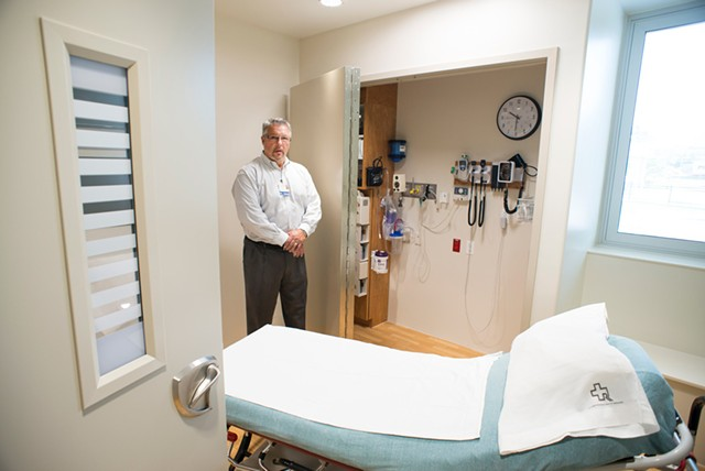 Emergency Department director Tom Rounds in a room outfitted for mental health patients at Rutland Regional Medical Center - CALEB KENNA