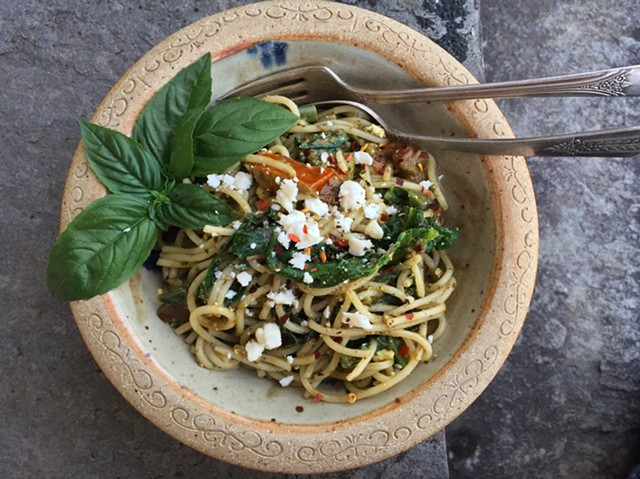 Pasta tossed with wilted kale, tomatoes, feta and pesto. - HANNAH PALMER EGAN