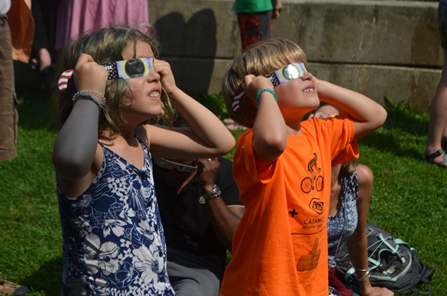 Kids take in the solar eclipse at the Fletcher Free Library in Burlington - KATIE JICKLING