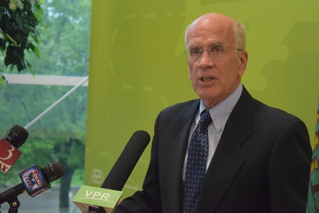 Congressman Peter Welch (D-Vt.) speaks to the media Tuesday at Burlington International Airport. - TERRI HALLENBECK