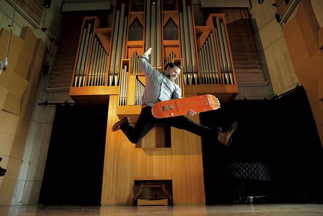 Matt LaRocca playing a guitar he built from an old skateboard - MATTHEW THORSEN