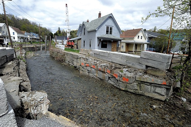 Flood-damaged homes and flood-control pylons in Gunners Brook in Barre - FILE: JEB WALLACE-BRODEUR