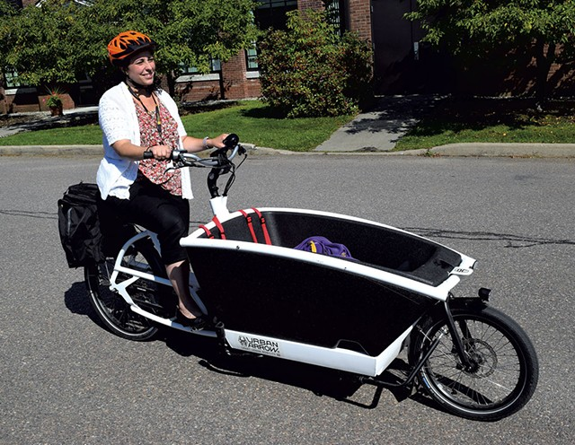 Stephanie Phillips with her family-style scooter - TERRI HALLENBECK