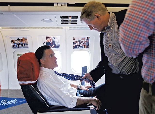 Mitt Romney (left) and Stuart Stevens talking aboard the Romney campaign plane in October 2012 - AP PHOTO/CHARLES DHARAPAK