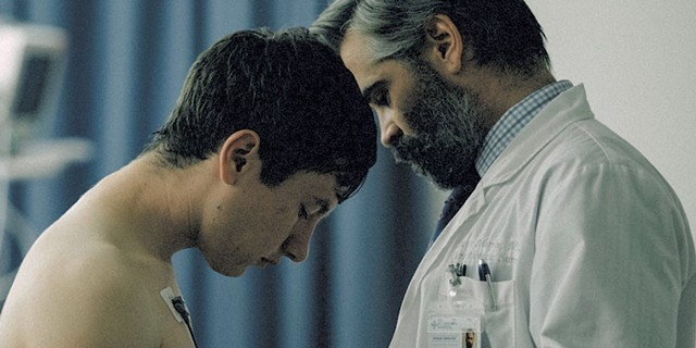 GOD COMPLEX Farrell plays a cardiologist navigating a perilous situation in Lanthimos' pitch-dark, hyperreal drama.