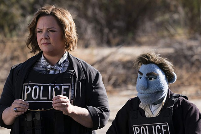 THE THIN BLUE LINE McCarthy turns out to have limited comic chemistry with puppets in Henson's sadly unfunny attempt at a twisted satire.