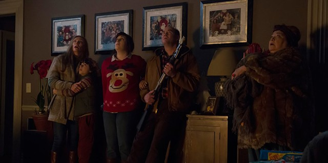 SCARY CHRISTMAS Ugly sweaters can't save a family from its own lack of seasonal faith in Dougherty's horror/comedy mishmash.