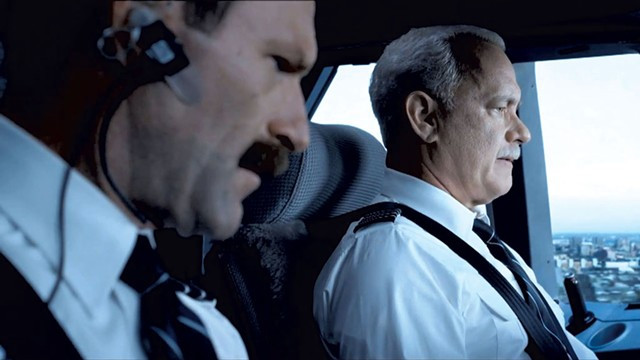 FLIGHT CONTROL Eckhart and Hanks star in a gripping and impressively conceived celebration of regular guys who are very good at their jobs.