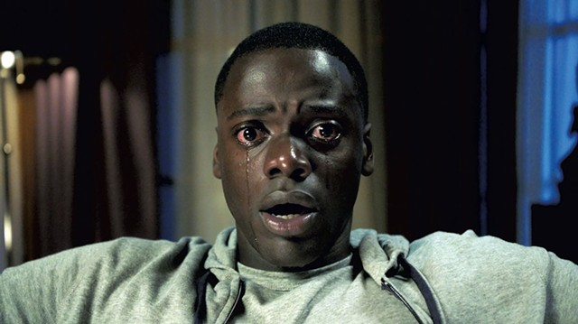 WHITE FRIGHT Kaluuya discovers that fear lives in the wealthy suburbs in Peele's socially conscious horror flick.