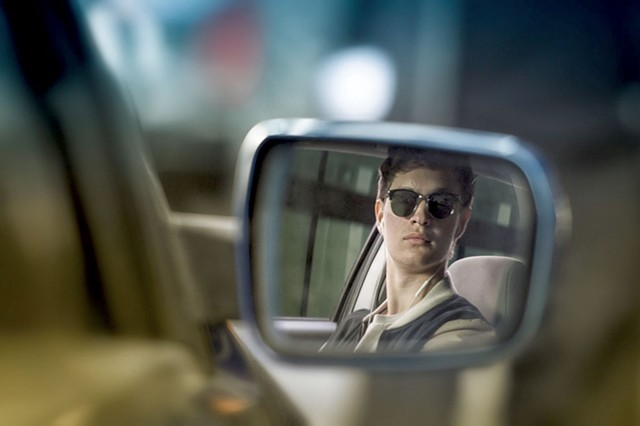 WHEEL WIZARD Elgort plays a getaway driver who's never without his tunes in Wright's musical action flick.