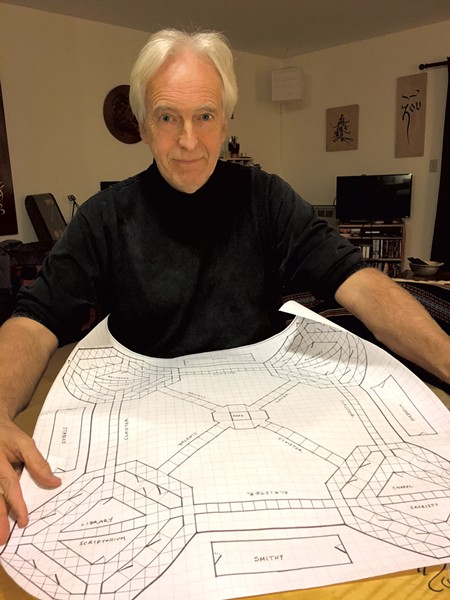 Tim Brookes with drawing for board game Glagolitic Abbey - PAMELA POLSTON