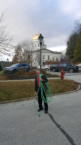 Gov. Phil Scott poses with his hose - COURTESY: GOV. PHIL SCOTT ADMINISTRATION