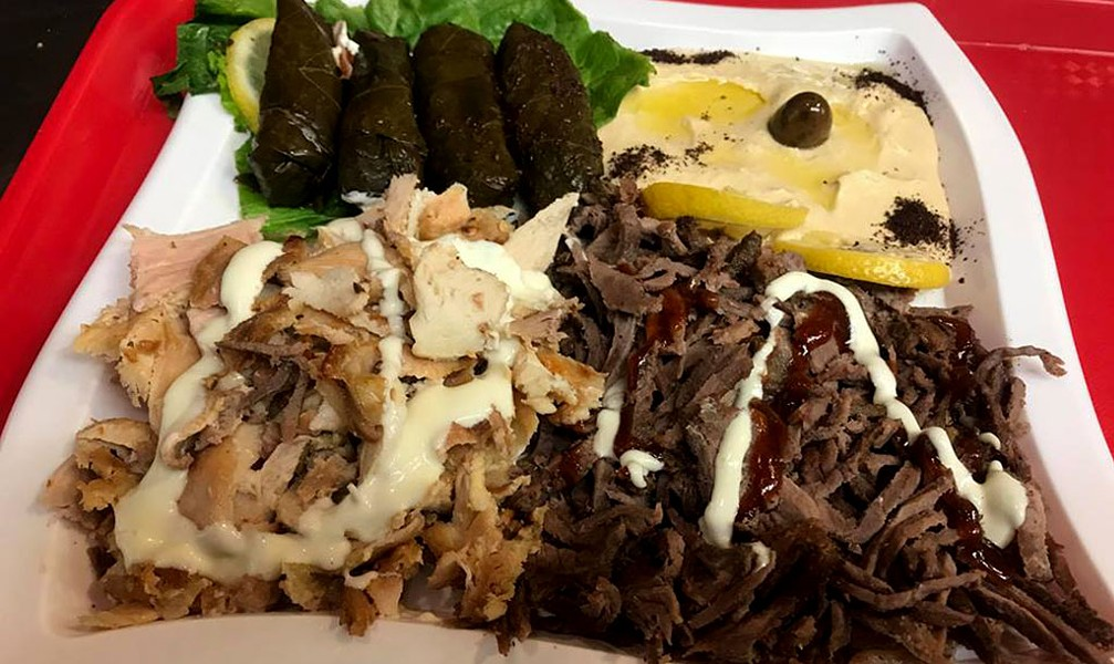 Chicken and beef shawarma with hummus and stuffed grape leaves at Mr. Shawarma - COURTESY OF MR. SHAWARMA