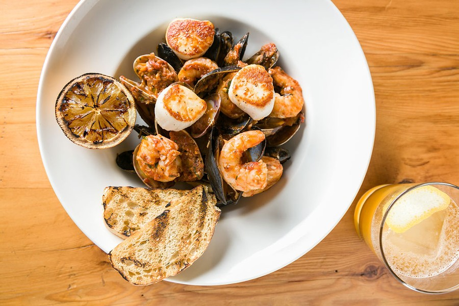 Cioppino and a Coladapin cocktail at Hatchet Tap and Table in Richmond - OLIVER PARINI