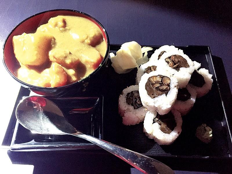 Curry and a sushi roll at Shinjuku Station Café - SALLY POLLAK