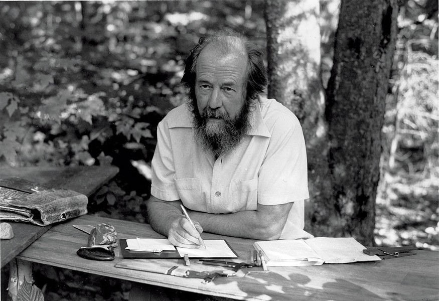 Solzhenitsyn in Cavendish, at his self-made table with birch legs. - COURTESY OF THE ALEKSANDR SOLZHENITSYN CENTER.