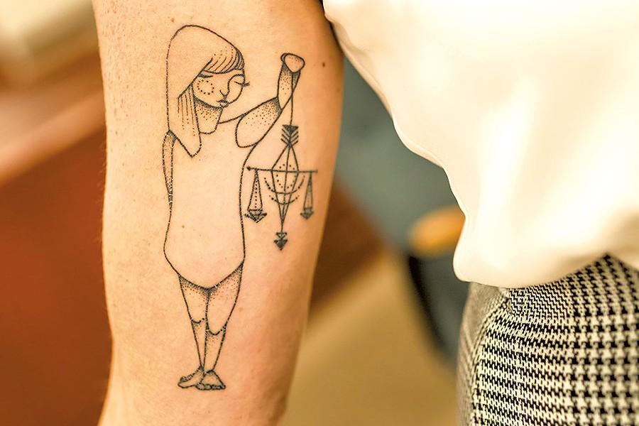 George's new tattoo - OLIVER PARINI
