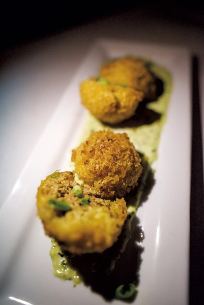 Arancini with saffron risotto, sweet corn, house herbs, sausage and cheddar at Cork Wine Bar & Market - GLENN RUSSELL