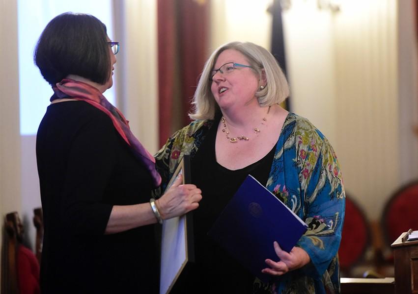 Allison Coyne Carroll receiving her award from VAC director Karen Mittelman - JEB WALLACE-BRODEUR