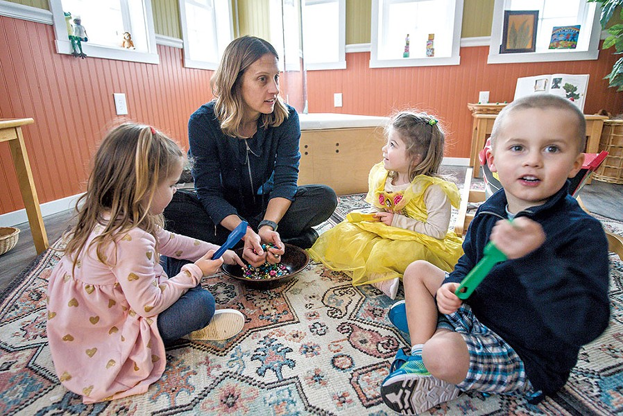 Kate Driver playing with 3-year-olds Lacey, Sadie and Tucker at Georgia's Next Generation - GLENN RUSSELL