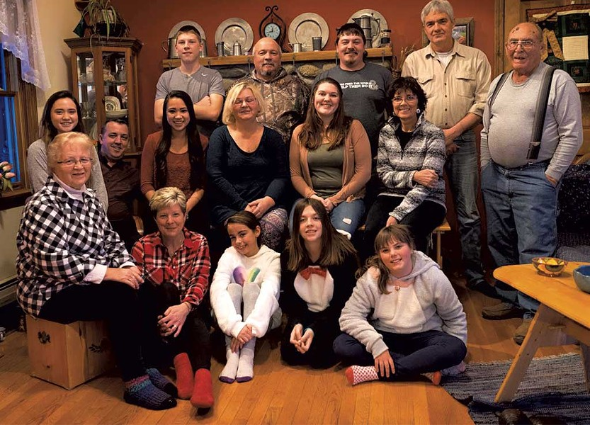 Davio family photo, Christmas 2017, with Jim (back row, second from left) surrounded by his family, including his mother, Jocelyn (front row, far left)